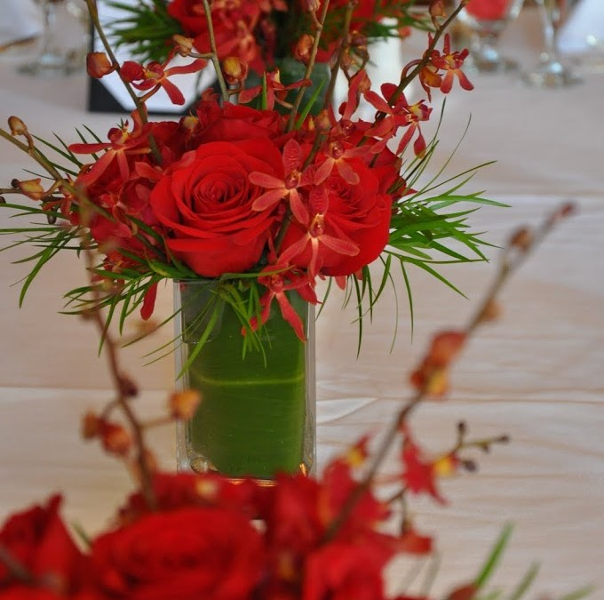 Red roses and aranda orchids